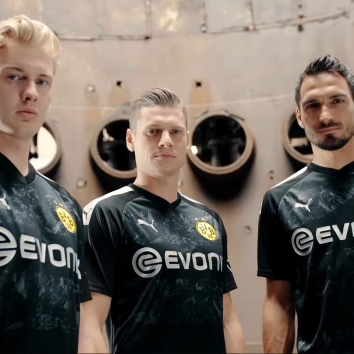 Borussia Dortmund players in front of the old blast furnace at Walas PHOENIX West in Dortmund, Germany.